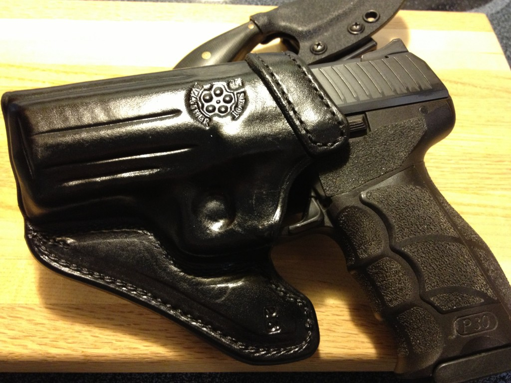 The leather work on the holster is top notch...perfect edges, flawless stitching, incredible forming detail.